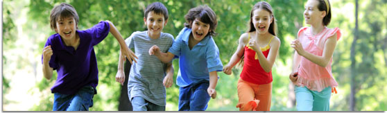 graphic banner of a group of young children running and laughing