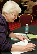 Barbara Rogers, P.N.P., Dorchester House, takes notes during a NACI meeting in Baltimore, MD.