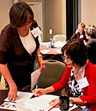 Dr. Denise Simons-Morton, DARD Director, NHLBI, at right, confers with Rachael Tracy, Acting NAEPP Coordinator, NHLBI