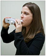 UW's Bonnie Rains demonstrates how to use a spirometer.