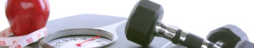 Apple avec un ruban à mesurer enroulé autour et des cloches muettes sur une balance.
