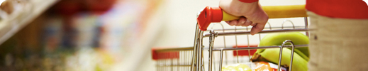 Woman pushing shopping cart in grocery store