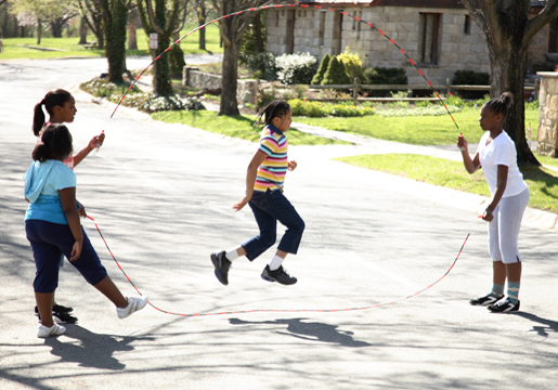 Four girls jumping rope