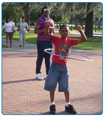 A child in Savannah hula hoops on We Can! Day