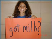 "Image of girl holding a sign that says, ""Got Milk?"""