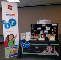 The ODS booth for wellness conferences incorporates We Can! materials.