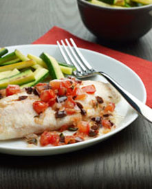 Baked tilapia with tomatoes on a plate
