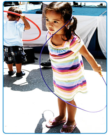 A young girl jumps rope at the Fit Kids Playground event