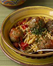 Turkey and beef meatballs with whole-wheat spaghetti in a bowl
