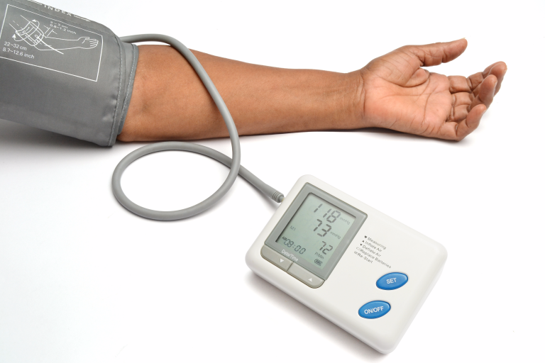 Photo of blood pressure monitor on a person's arm