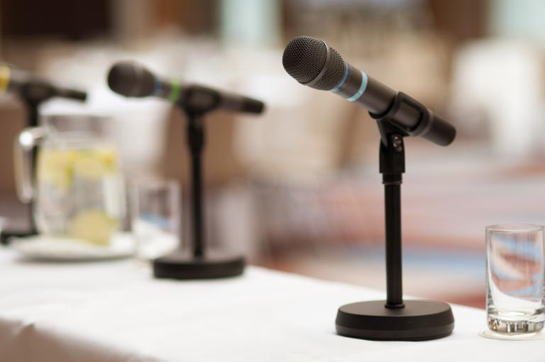 Close up of microphone on a table, ready for speakers