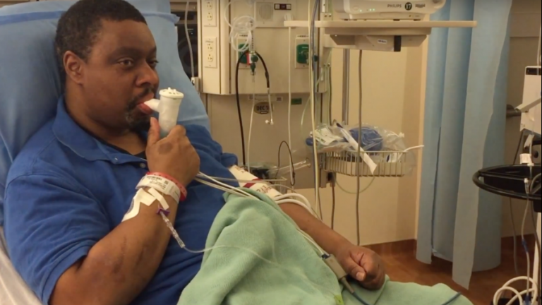 African american patient with inhaler in hospital room