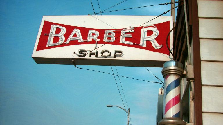 Street sign of a Barber Shop
