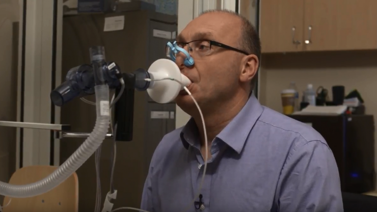 man taking breathing test