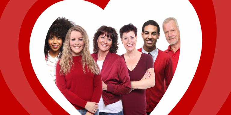People wearing red under a heart shaped frame