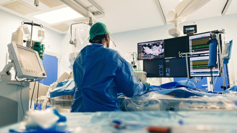 Surgeon performing an ablation procedure in operating room.