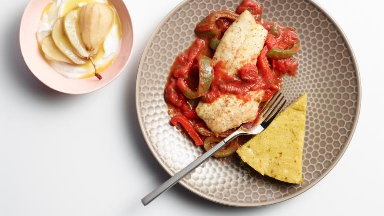 Plate with heart healthy food: red snapper with zesty tomato sauce and yogurt with fruit on the side
