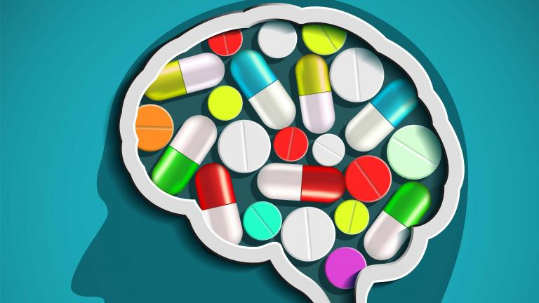 Illustration of human head with brain and pills.