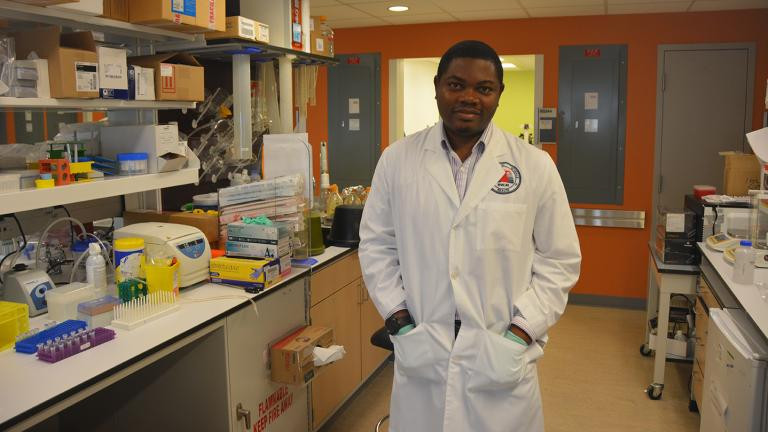 Dr. Oyebola in the lab.