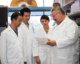 Dr. Doug Engel, University of Michigan, (Right) speaks with members of his lab